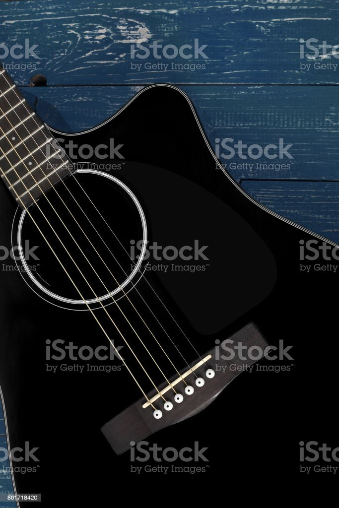 Musical instrument - Silhouette Black cutaway acoustic guitar wood background stock photo