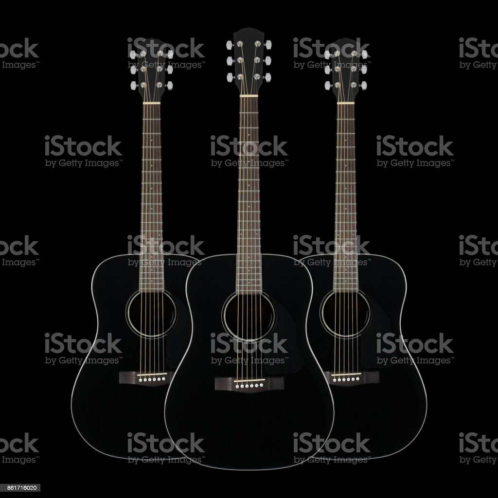 Musical instrument - Three Black acoustic guitar stock photo