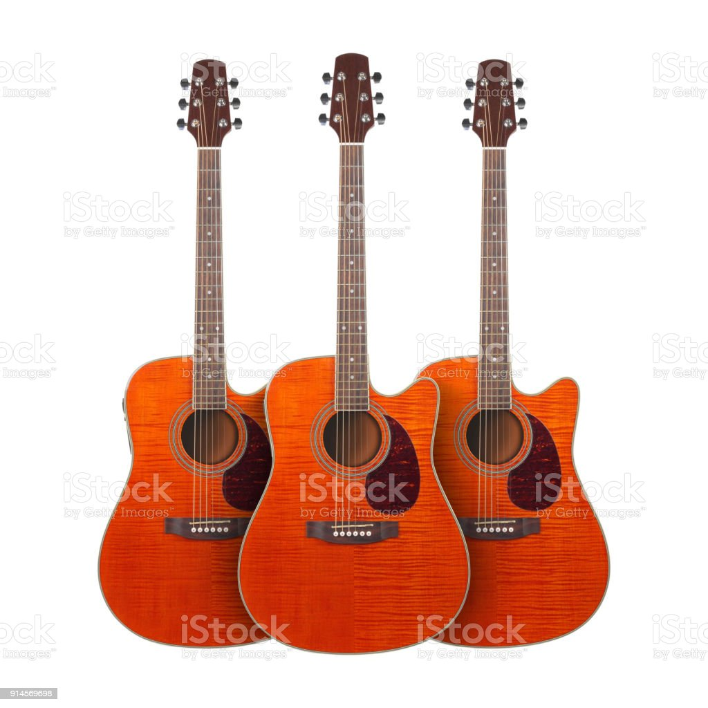 Musical instrument - Three orange Flame maple cutaway acoustic guitar isolated in white stock photo