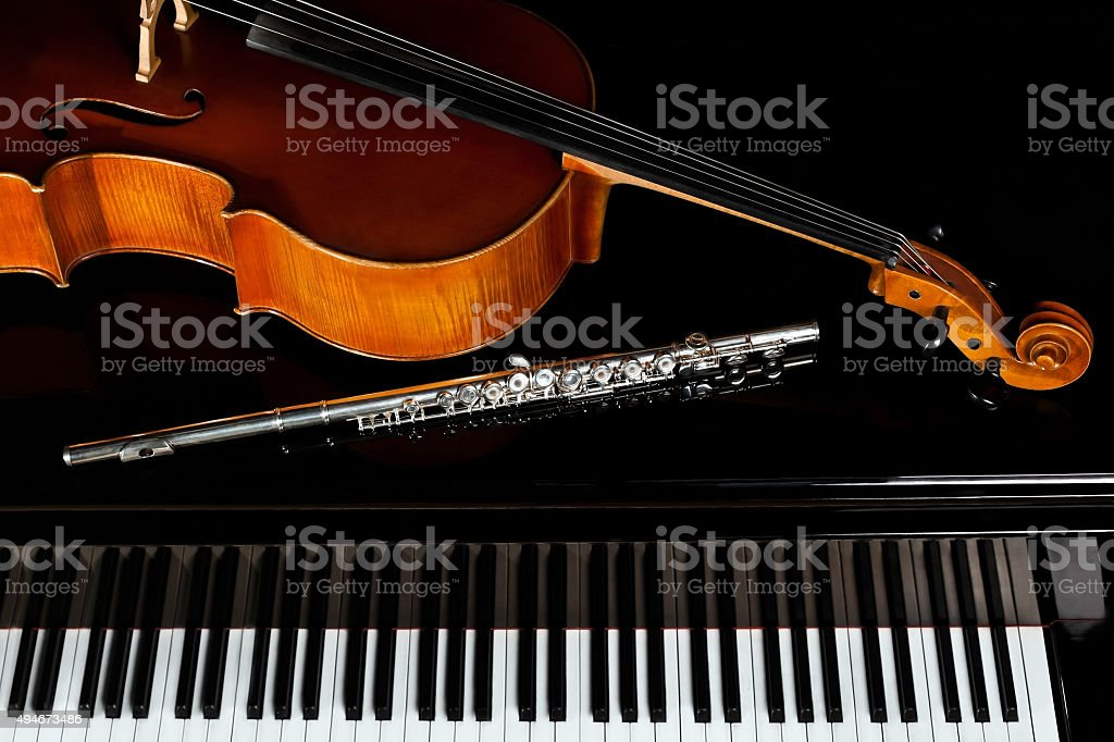 Musical instruments lying on the piano stock photo