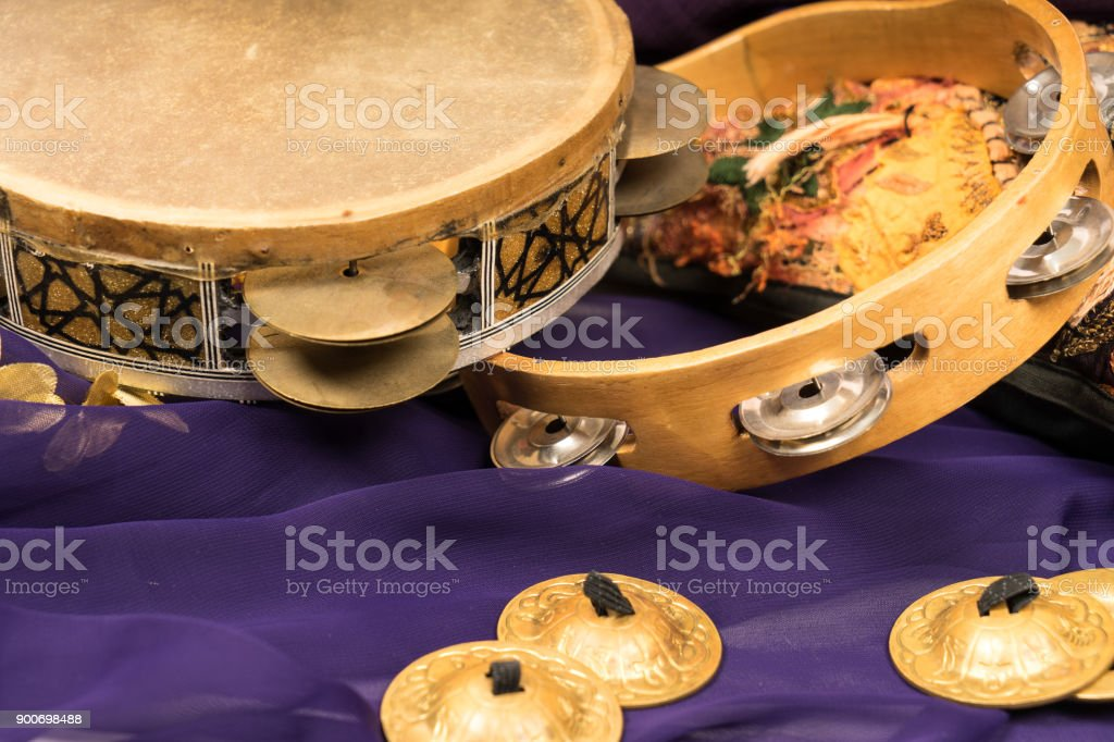 musical instruments of a bellydance percussiongroup with darbuka's, tambourines and zills stock photo