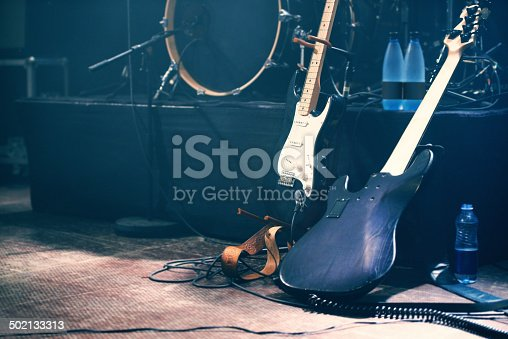 Musical instruments on an empty stage before a show.