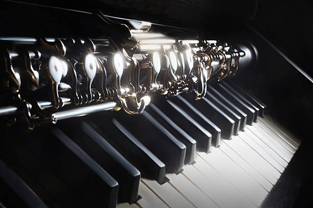 Musical instruments piano and oboe Musical instruments piano and oboe. Classical music instrument on black keyboard player stock pictures, royalty-free photos & images