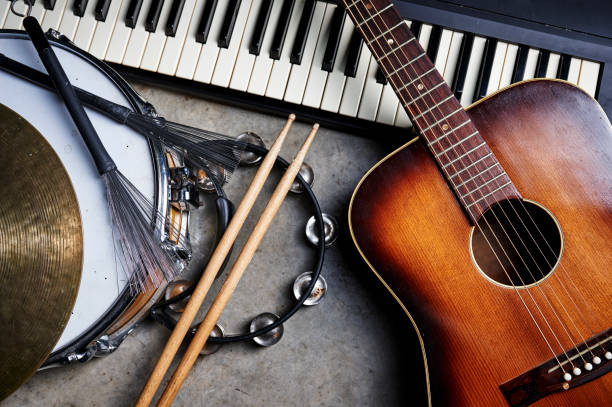 musical instruments a group of musical instruments including a guitar, drum, and keyboard drum kit stock pictures, royalty-free photos & images