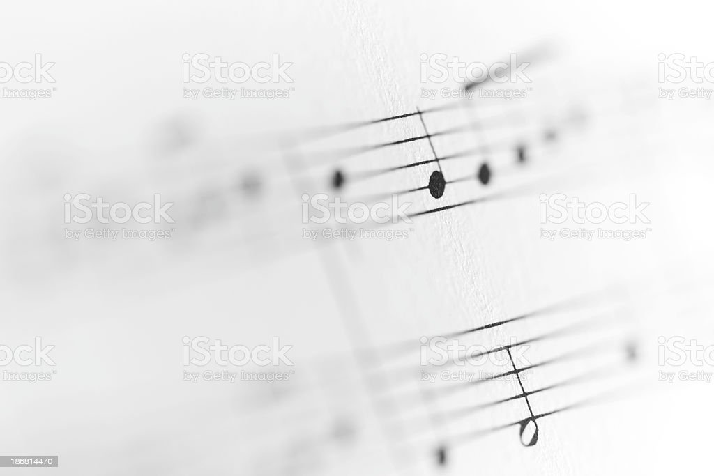 Musical notes fading to white royalty-free stock photo