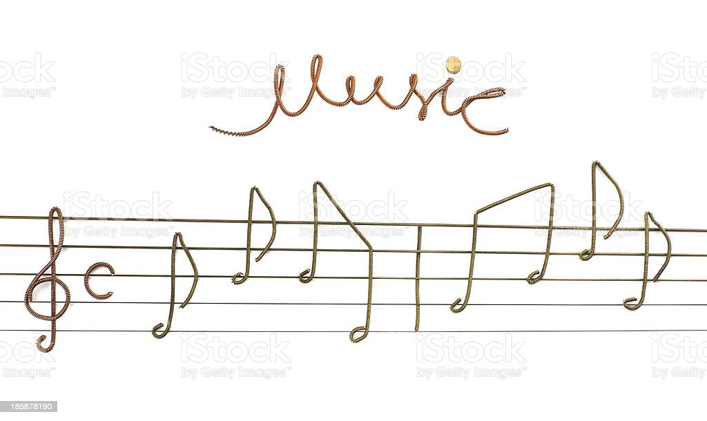 Musical notes made from pieces of guitar strings. royalty-free stock photo