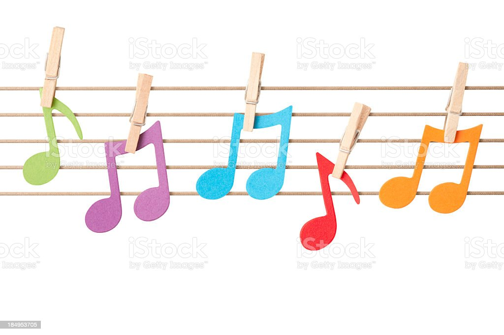 Musical notes pegged to string stave stock photo