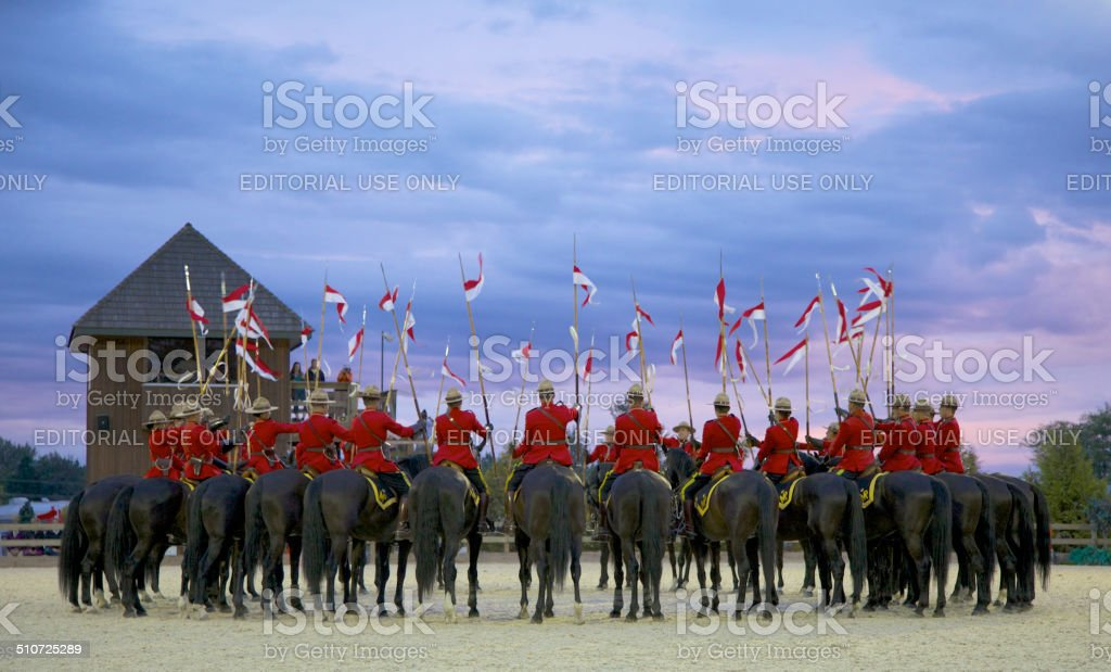 RCMP Musical Ride at sunset stock photo