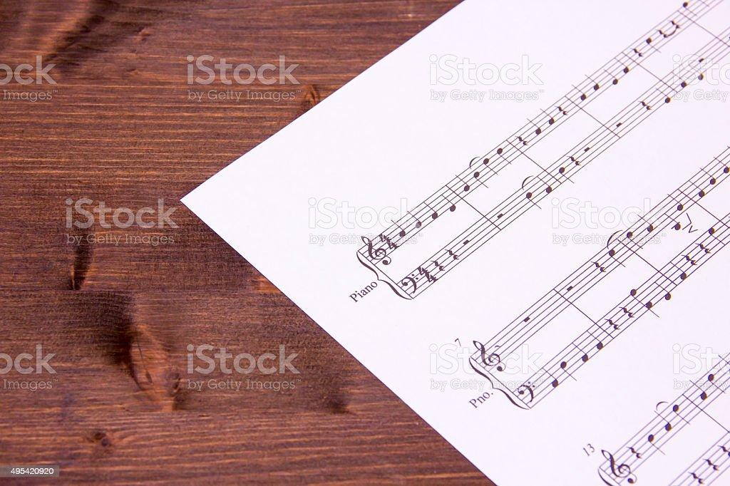Musical score on wood stock photo