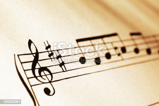 Close-up shot of musical symbols on sheet music in sepia tone.Similar images -