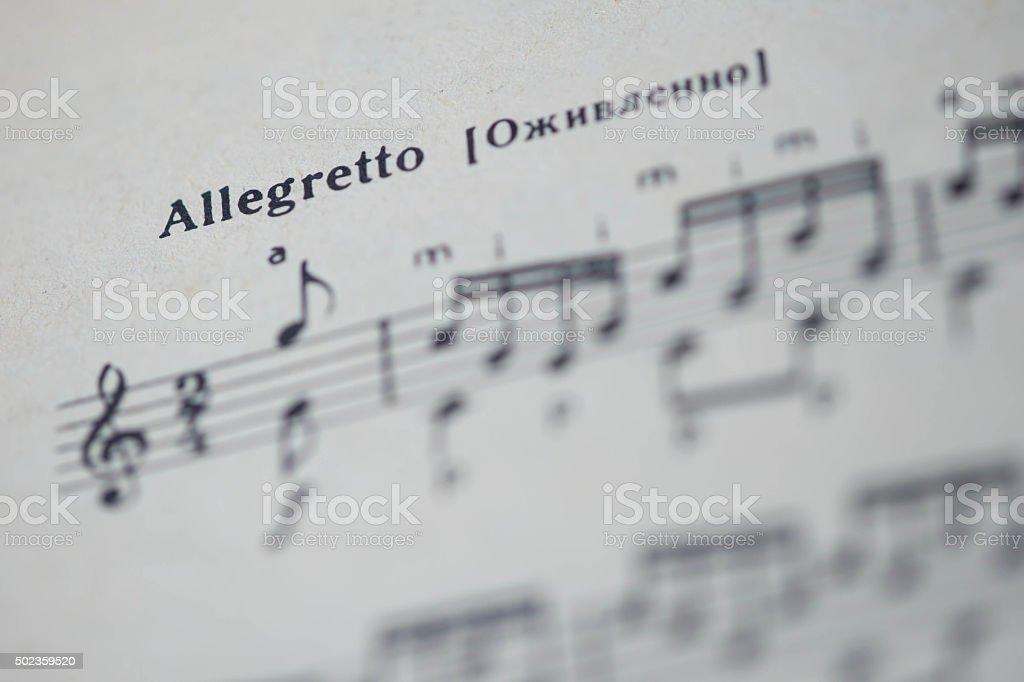 Musical tempo 'Allegretto' in a music book close up stock photo