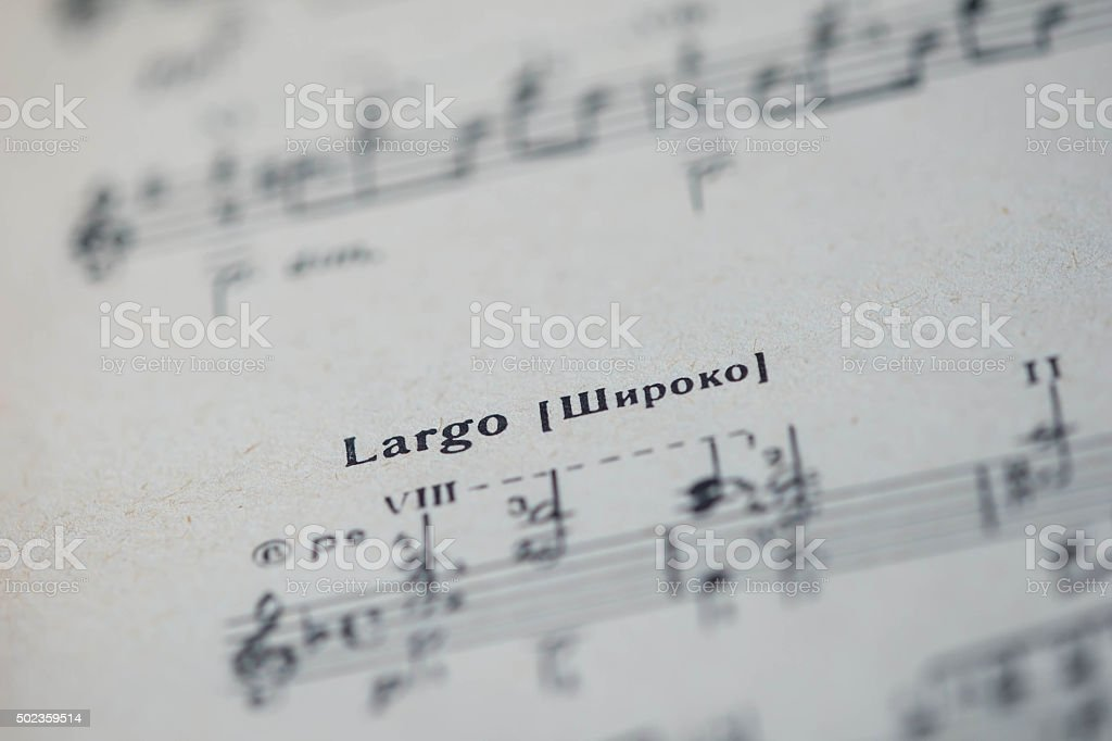 Musical tempo 'Largo' in a music book close up stock photo