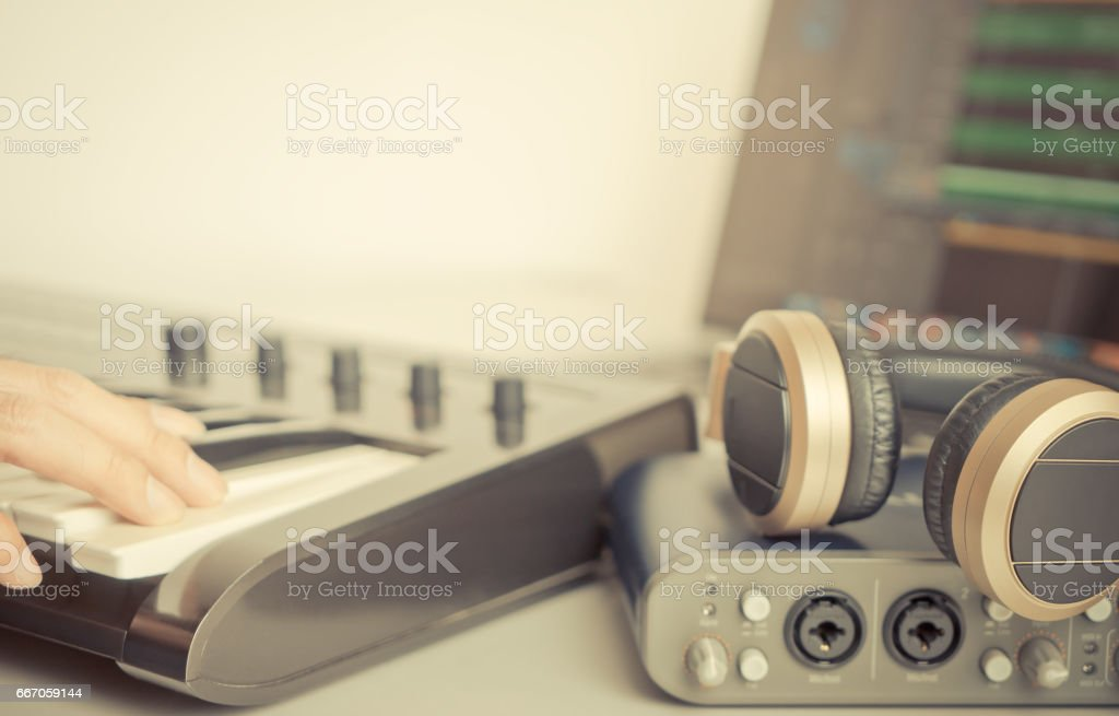 Musiccian is using Portable Home Music studio production equipment to make music stock photo