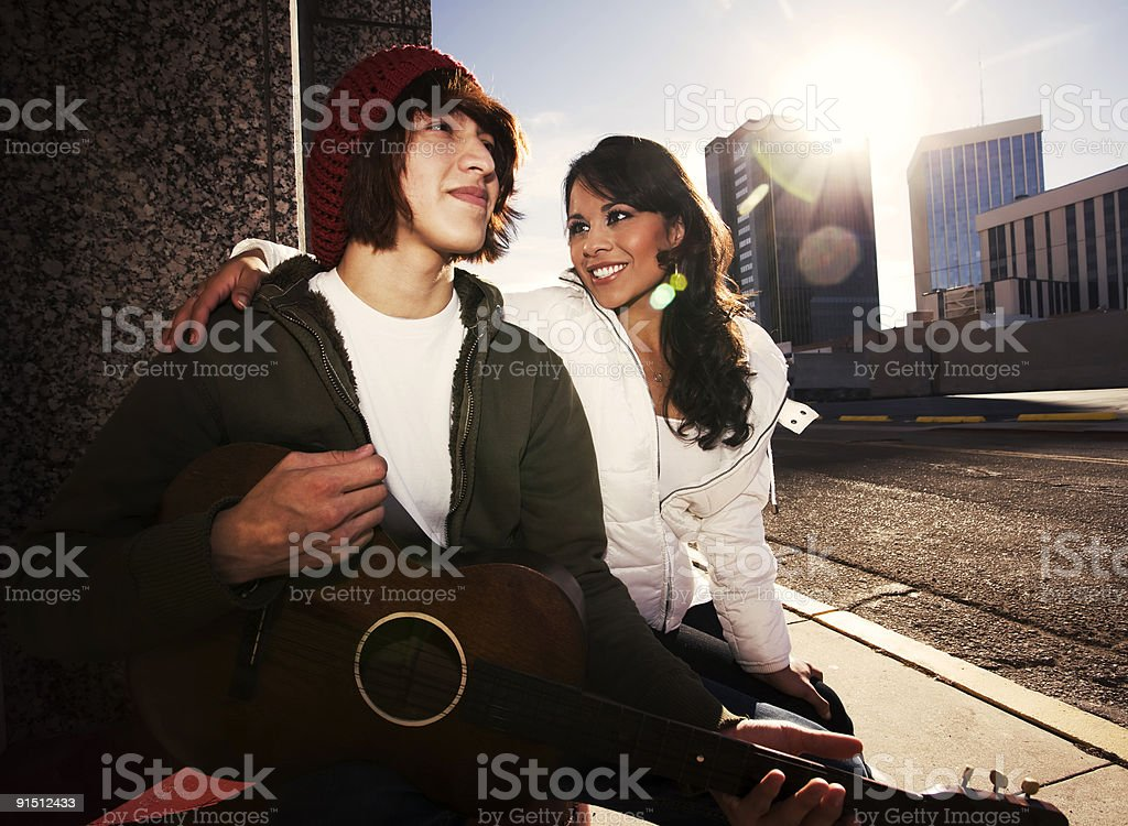 Musician and Pretty Girlfriend Downtown royalty-free stock photo