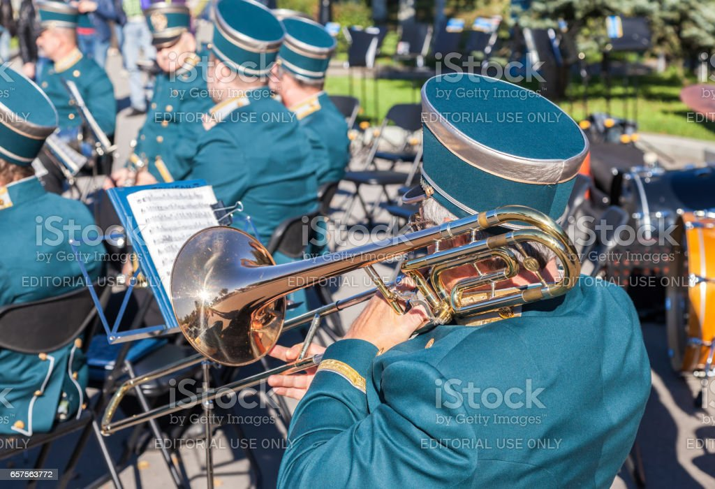 Musician brass band playing the trombone on a sunny day stock photo