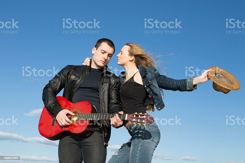 Musician couple over the blue sky royalty-free stock photo
