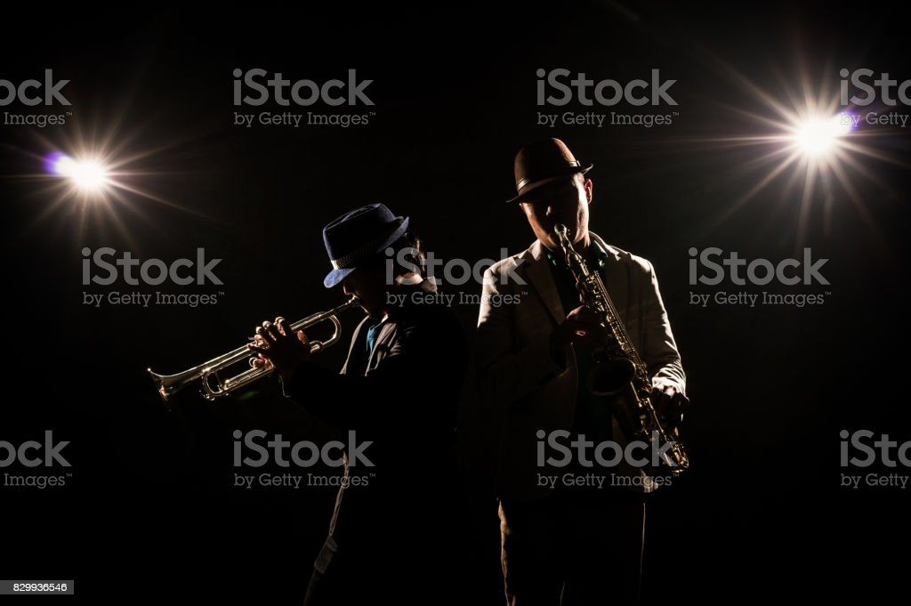Musician Duo band playing the Trumpet with spot light and lens flare on the stage, musical concept stock photo