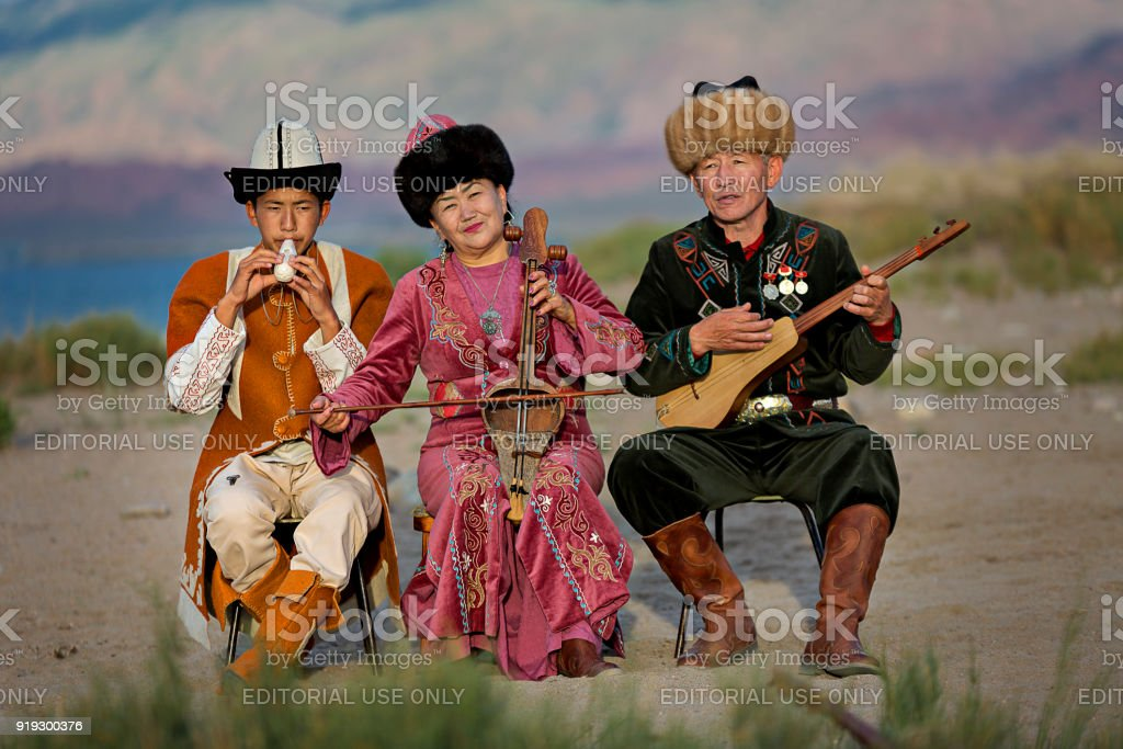 Musician family, in Issyk Kul, Kyrgyzstan. stock photo