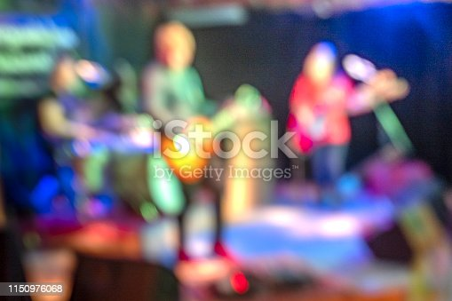 Musician group on stage out of focus