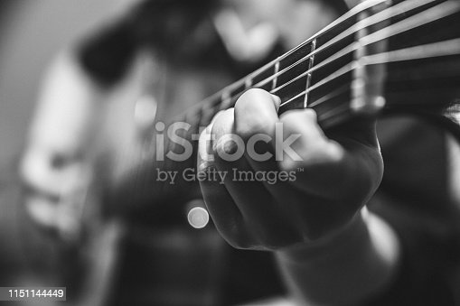 musician guitar player plays the guitar closeup vintage tone with noise grain effect