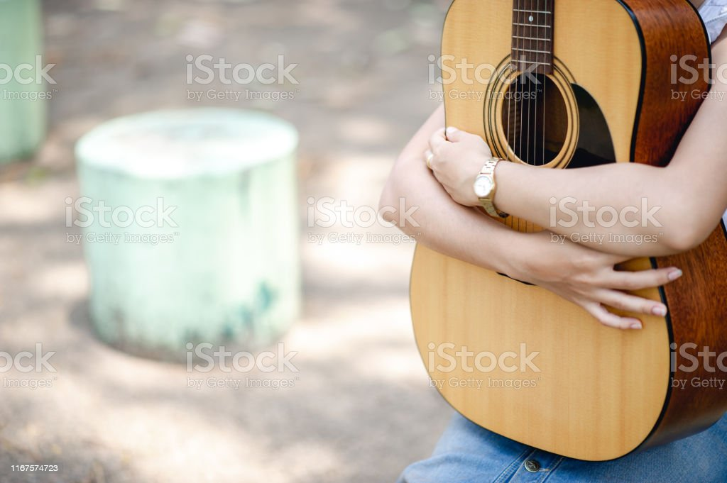 Musician hands and acoustic guitars, musical instruments with very...