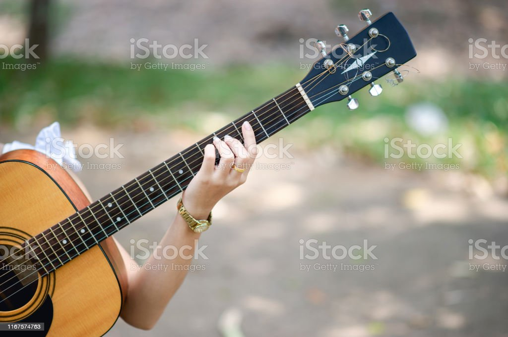 Musician Hands And Acoustic Guitars Musical Instruments With Very Good Sound Musical Instrument Concept Stock Photo Download Image Now Istock
