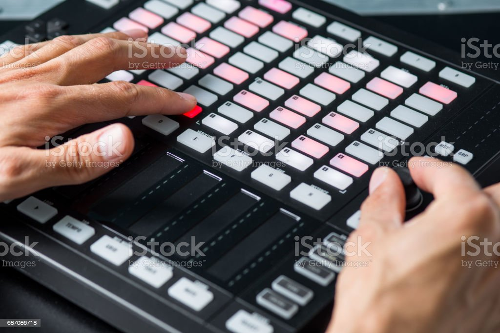 Musician Hands Manipulate Controller, Music Equipment stock photo