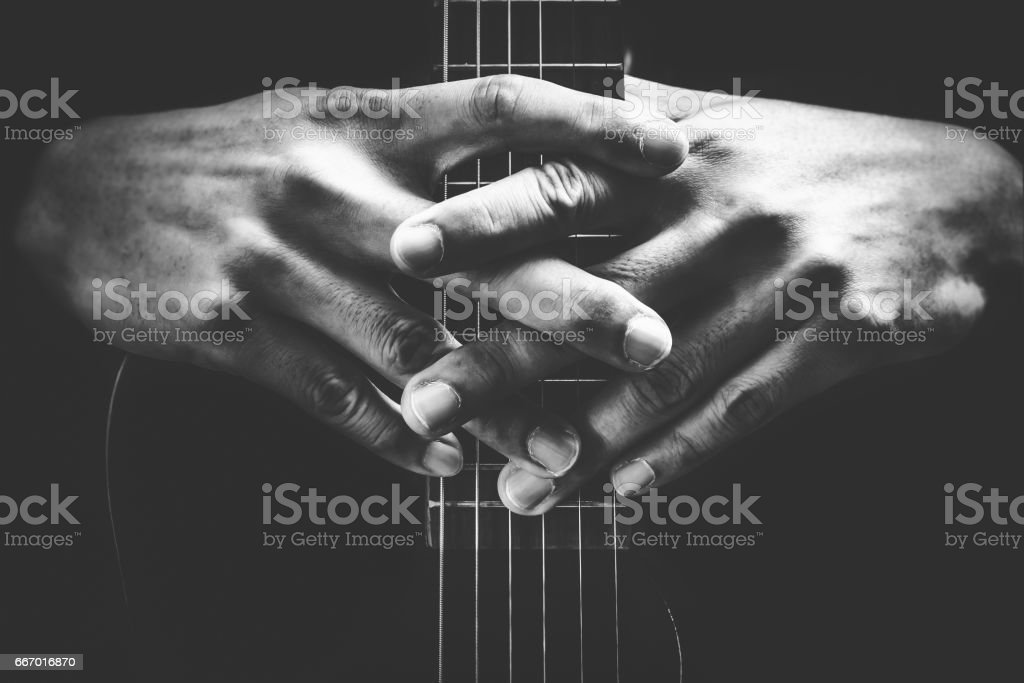 musician hands on guitar neck stock photo