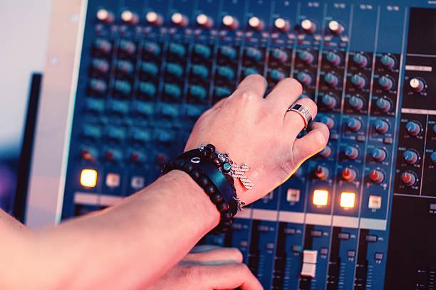 Musician hands tuning sound panel closeup stock photo
