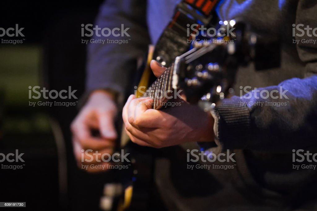 Musician in night club - guitarist holding soundboard electric guitar stock photo