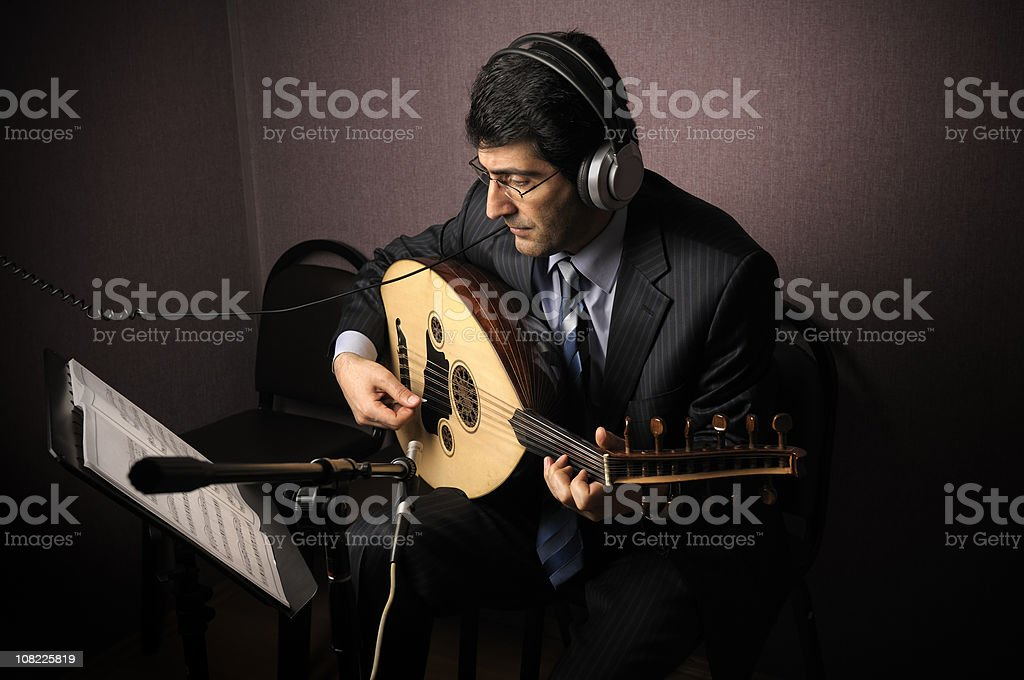 Musician in Recording Studio stock photo