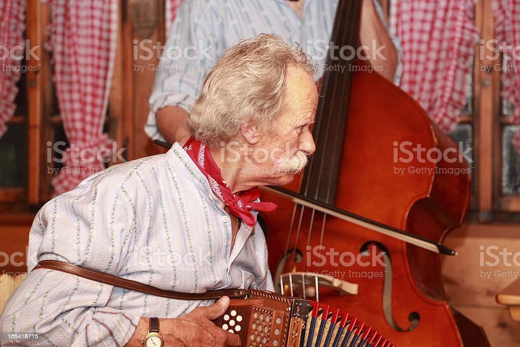 musician in traditional swiss yodelling trio stock photo