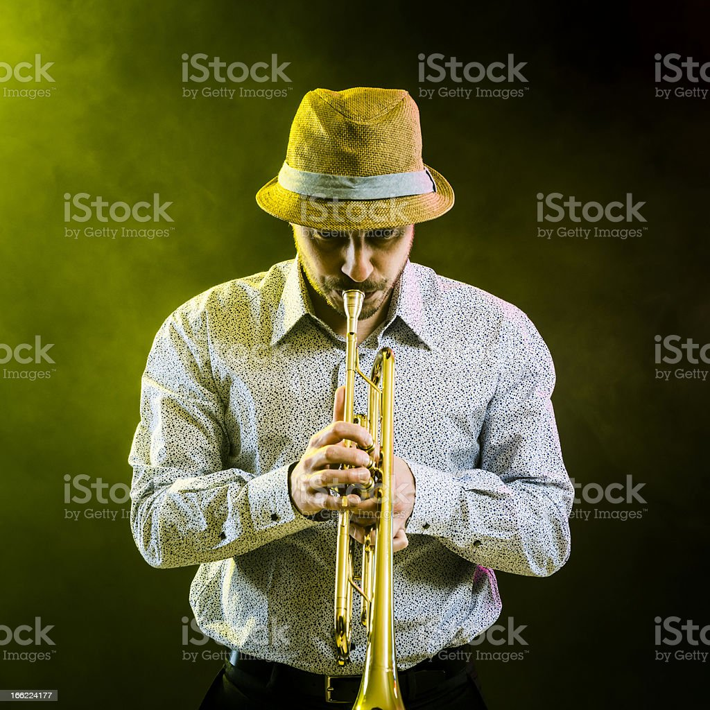 Musician is playing on the trumpet on stage at concert royalty-free stock photo