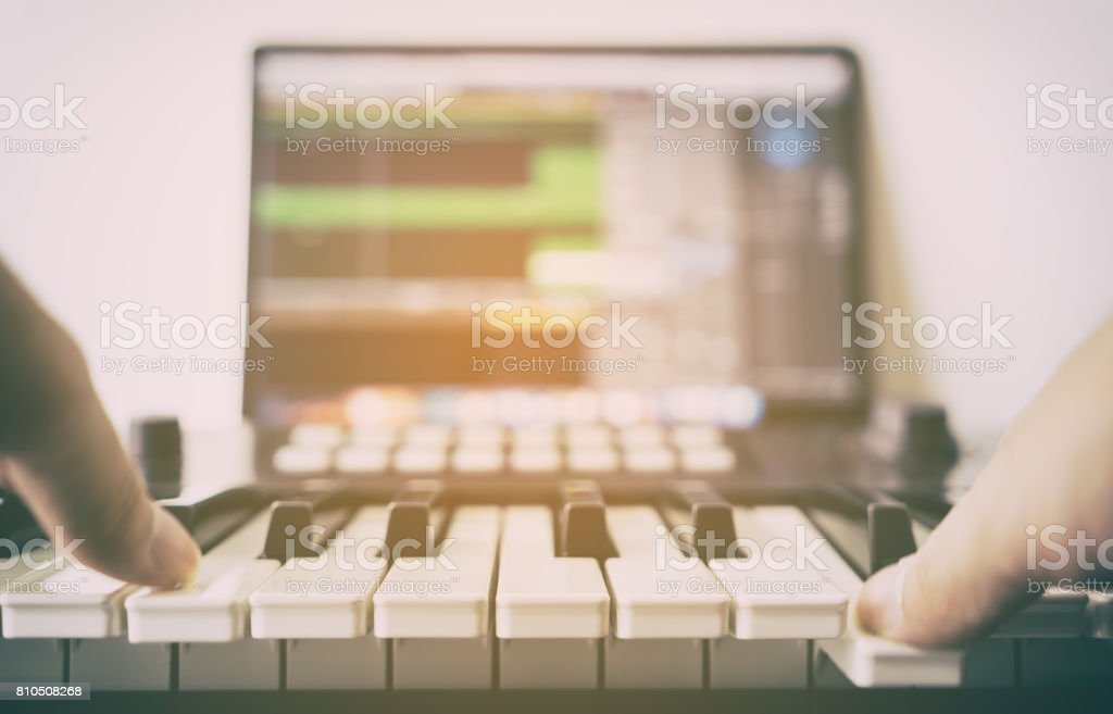 Musician is recording Electronic music on computer stock photo