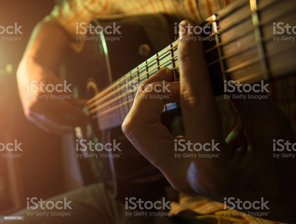 Musician man is playing the guitar on the concert stock photo