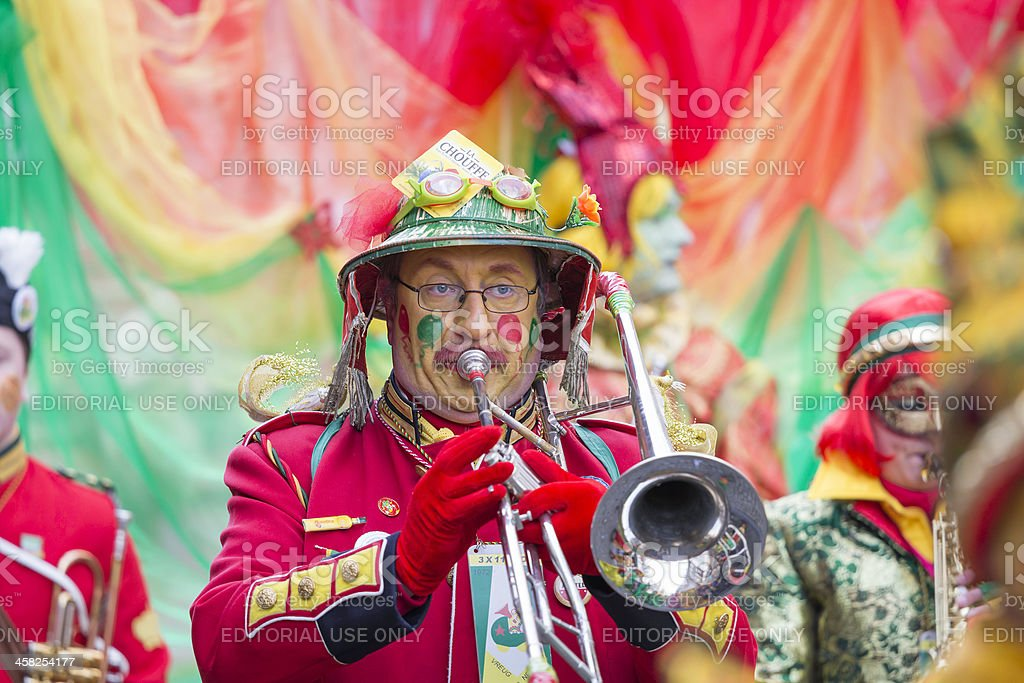 Musician marching in red costume at carnival parade of Maastricht royalty-free stock photo