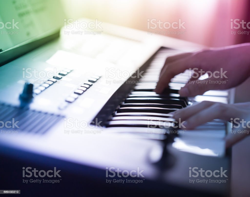 A musician performing on the keyboard stock photo