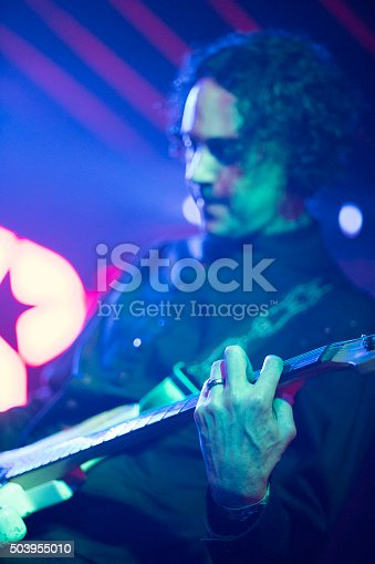 849313464istockphoto Musician play guitar on the stage in a live performance 503955010