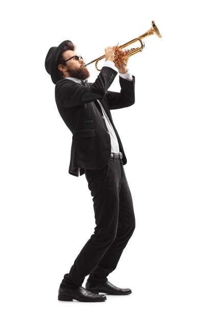 musician playing a trumpet - musician stock photos and pictures