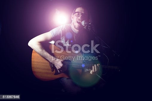 istock Musician playing acoustic guitar and singing 513367646