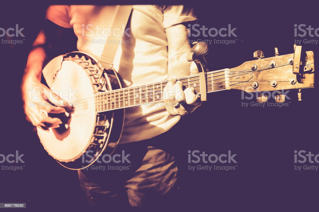 musician playing banjo in retro filter photo stock photo