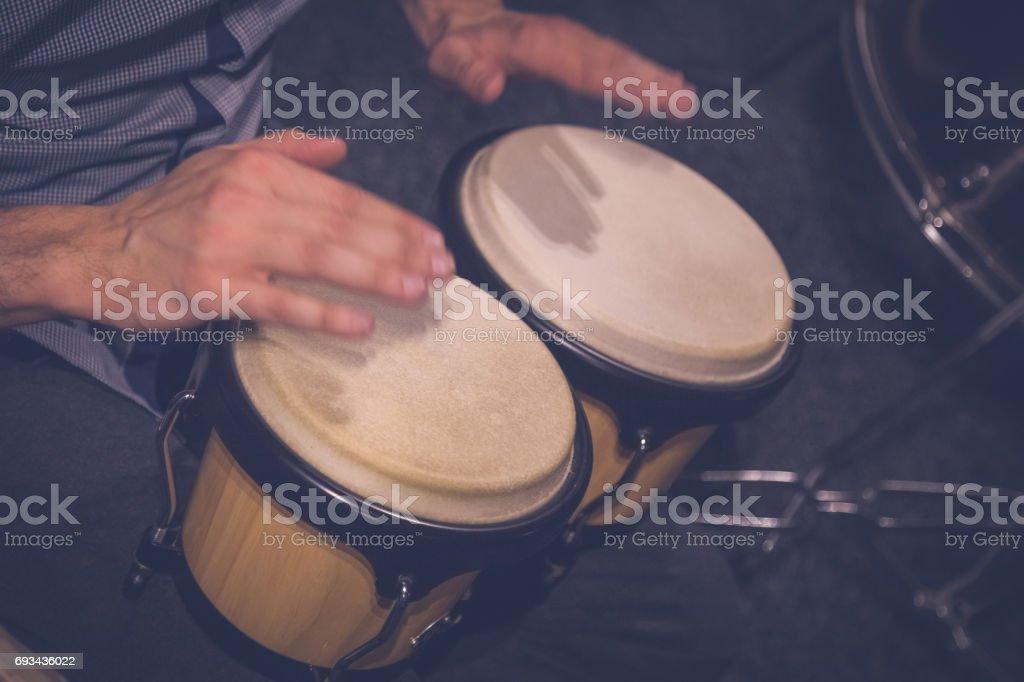 Musician playing bongos stock photo