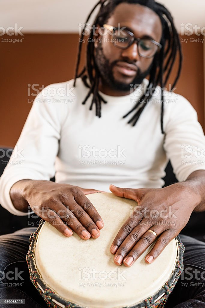 Musician Playing Drum. stock photo