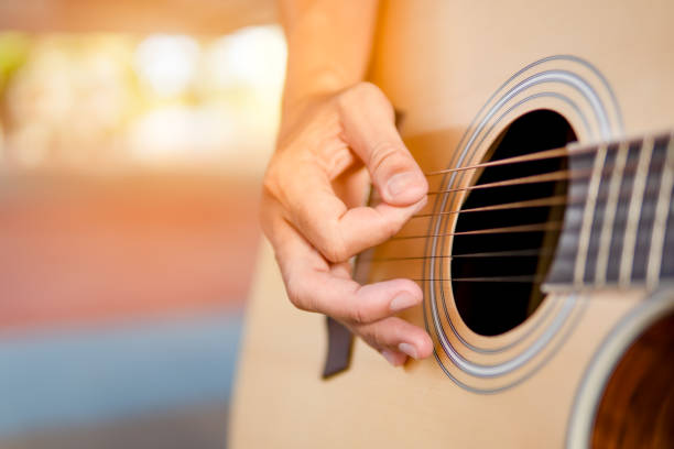 musician playing guitar classic and singing song, close up hand - music style stock pictures, royalty-free photos & images