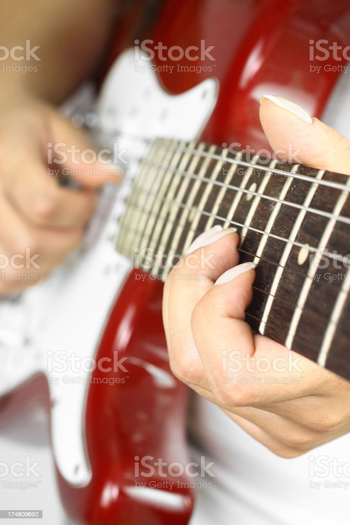 Musician playing guitar royalty-free stock photo
