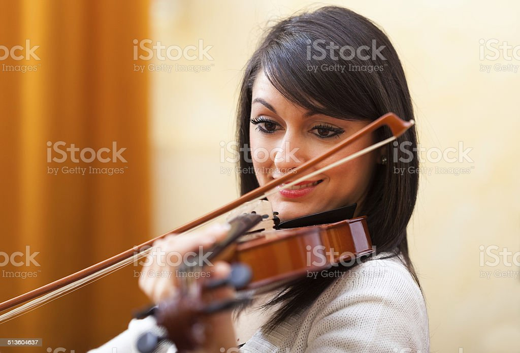 Musician playing her violin stock photo