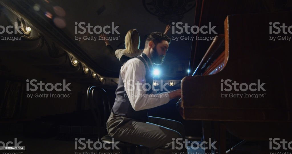 Musician playing on a theater stage stock photo