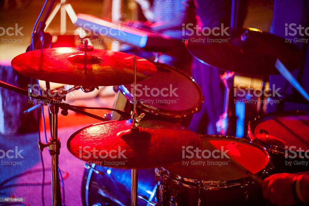Drums with piano player in the background