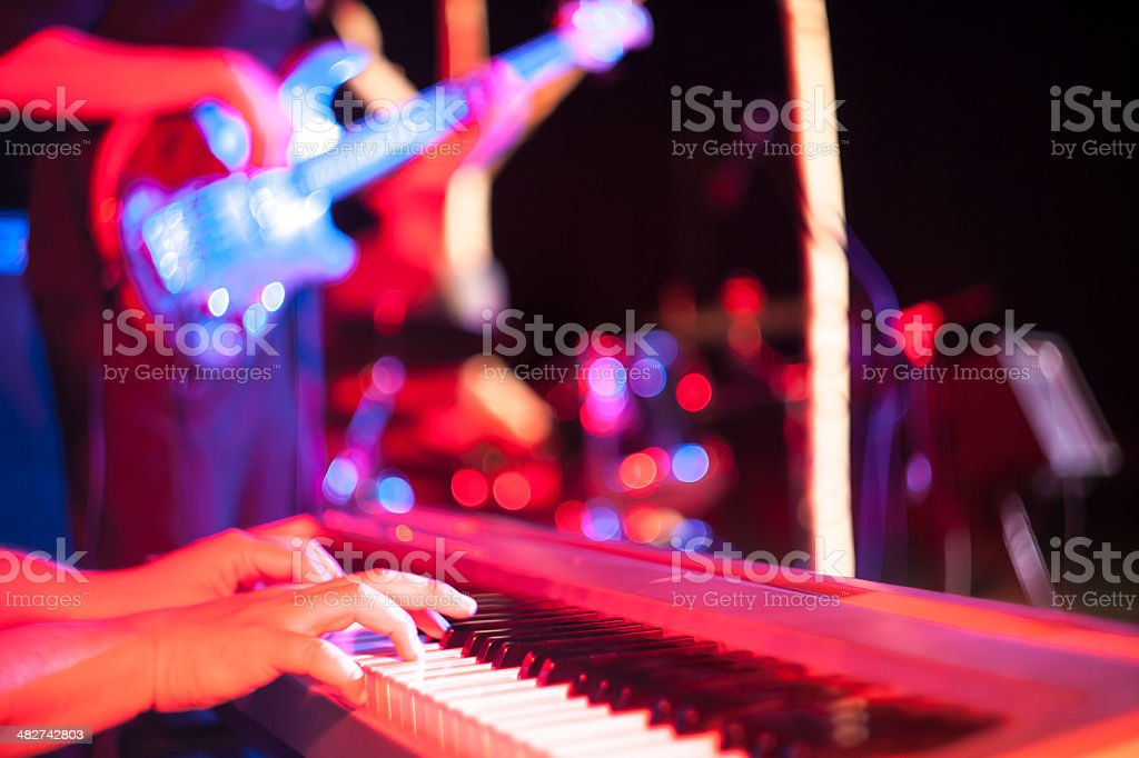 Musician playing on electric keyboard at jazz music festival stock photo