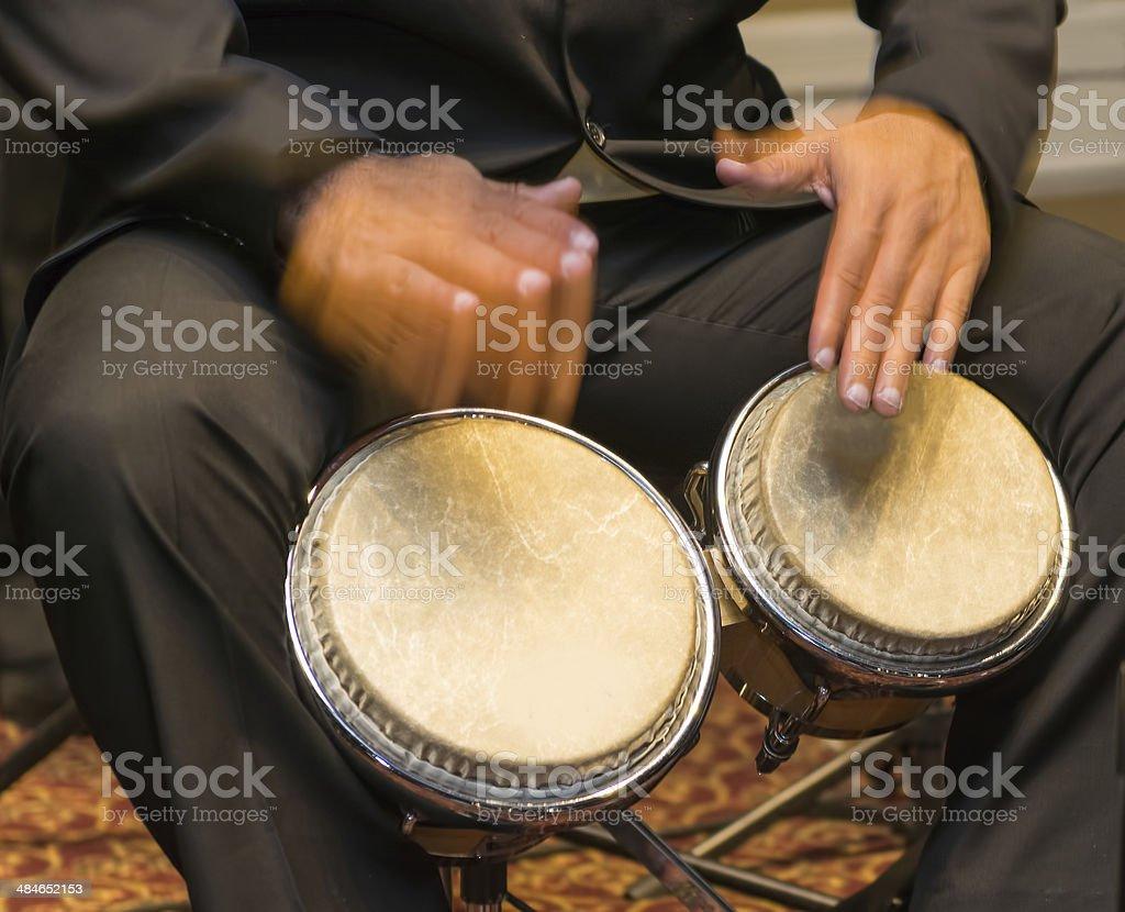 Musician playing the bongos stock photo